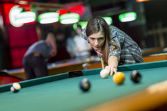 Young woman playing pool. Close view of the young woman playing pool Stock Photography
