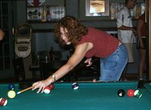 Young woman playing pool stock images