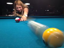 Young woman playing pool Stock Photography