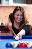 Young woman playing pool Stock Photos