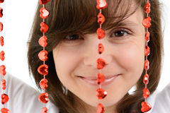 Young woman playing with a red chain of hearts Stock Images