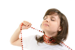 Young woman playing with a red chain of hearts Royalty Free Stock Photos