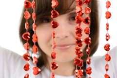 Young woman playing with a red chain of hearts Stock Image