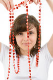 Young woman playing with a red chain of hearts Royalty Free Stock Images