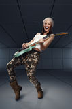 Young woman playing rock guitar and singing Royalty Free Stock Photography