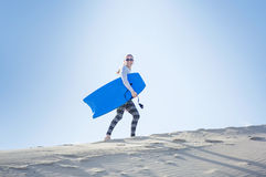 Young Woman Playing in the Sand Dunes Outdoor Lifestyle Royalty Free Stock Photos