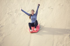 Young Woman Playing in the Sand Dunes Outdoor Lifestyle Stock Photography