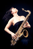 Young Woman Playing The Sax Royalty Free Stock Image