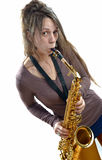 Young woman playing the saxophone Royalty Free Stock Images
