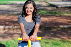 Young woman playing in a seesaw Royalty Free Stock Photo