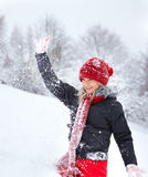 Young woman playing with snow Stock Photos