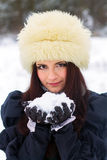 Young woman playing with snow Stock Images
