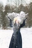 Young woman playing with snow Royalty Free Stock Photo