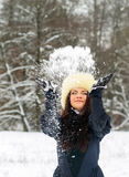 Young woman playing with snow Stock Photography