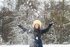 Young woman playing with snow Royalty Free Stock Photos