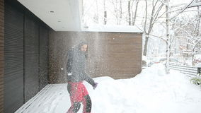 Young woman playing with snow stock footage