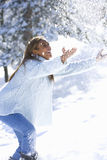 Young woman playing in the snow Royalty Free Stock Images
