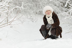 Young woman playing with snow Royalty Free Stock Image