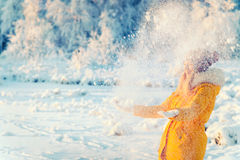 Young Woman playing with snow Outdoor Winter Lifestyle. Happiness emotions nature on background stock images