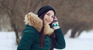Young woman playing with snow in park royalty free stock photos