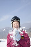 Young Woman Playing with Snow in Ski Resort Royalty Free Stock Photos