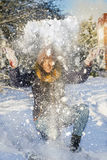 Young woman playing with snow in winter Royalty Free Stock Photos