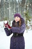 Young woman playing in snowball fights Royalty Free Stock Photography