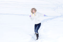 Young woman playing with snowball Stock Photo