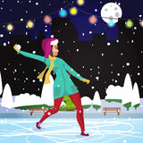 Young woman playing in the snowballs at night on the street Royalty Free Stock Photos