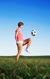 Young Woman Playing Soccer Royalty Free Stock Image