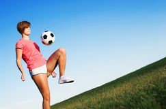 Young Woman Playing Soccer Stock Photos