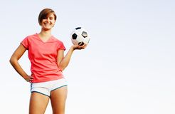 Young Woman Playing Soccer Royalty Free Stock Photography