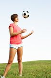 Young Woman Playing Soccer Stock Images