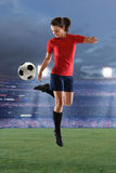 Young Woman Playing Soccer Stock Photo