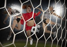 Young woman playing soccer royalty free stock photos