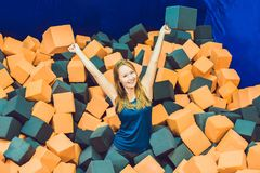 Young woman playing with soft blocks at indoor children playgrou stock images