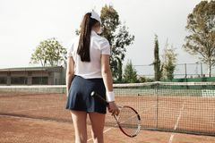 Young woman playing tennis on court royalty free stock images