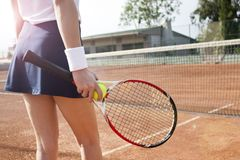 Young woman playing tennis on court. stock images