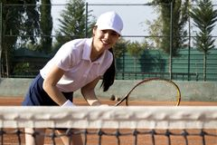 Young woman playing tennis on court. royalty free stock photography
