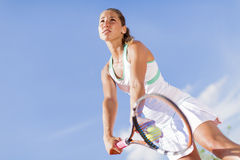 Young woman playing tennis Royalty Free Stock Photography
