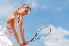 Young woman playing tennis Stock Photo