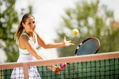 Young woman playing tennis outdoor royalty free stock photos