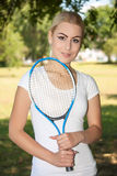 Young woman playing tennis. Portrait of woman playing tennis royalty free stock photo