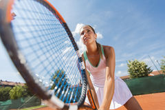Young woman playing tennis Stock Image