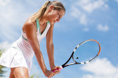 Young woman playing tennis Royalty Free Stock Images