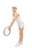 Young woman playing tennis and smiling Royalty Free Stock Image