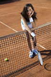 Young woman playing tennis Stock Photography