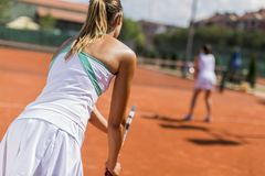 Young woman playing tennis Stock Images