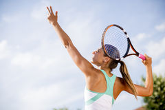 Young woman playing tennis royalty free stock photos