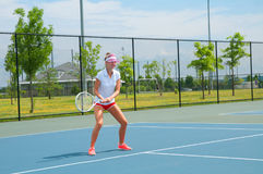 Young woman is playing tennis on the tennis court Stock Photography